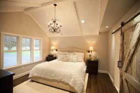 keller farmhouse bedroom with vaulted ceiling barn door neutral
