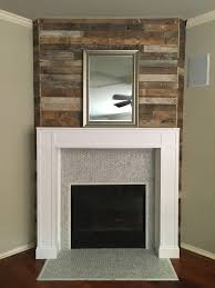 rustic contemporary fireplace salvaged wood from floor to ceiling