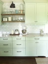 nice cabinet color and full wall of subway tile with open shelving
