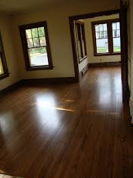 dark wood trim with hardwood floors and lighter not sterile white