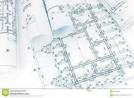 architectural building plans rolled building plans on architectural blueprint background stock