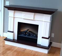 interior white fireplace mantel black top connected grey wall