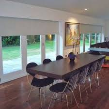 Blinds Or Curtains For French Doors - sunscreen roller blinds over bi fold doors in living room