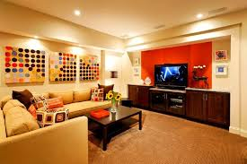 Cheerful Family Room With Orange And Cream Painting Color For - Color schemes for family room