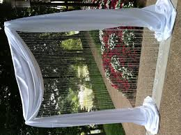 wedding backdrop ideas with columns but with fewer columns of flower petals maybe the coffee filter