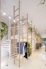 raumteiler verschiebbar clothes hang from wooden ladders in mit mat mama store stauraum