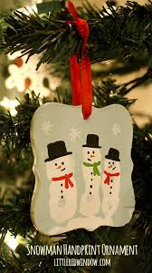 snowman handprint ornament window
