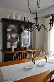 rustic maple winter dining room and vintage agricultural ironstone some wintery type decor with the faux snow and votive cup in the trio of vases the boxwood clippings from our garden have dried out and are tied on with