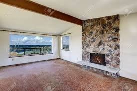 living room with vaulted ceiling bright empty living room with rocky fireplace vaulted ceiling
