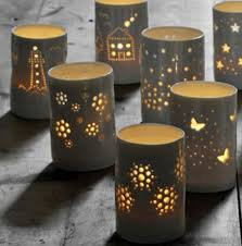 light ceramic tea light holders do this with tin cans