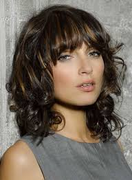 new haircuts for curly hair curly layered hair cut with bangs women medium haircut