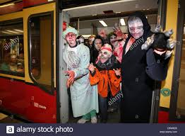 people dressed up as monsters take the city train from potsdam