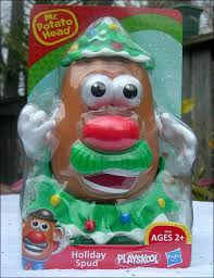 it s mr potato dressed like a tree singing the