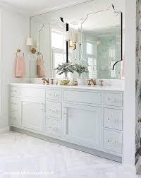 Green Bathroom Vanities A White Marble Herringbone Tile Floor Leads To A Stunning Bathroom