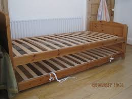 solid wood single bed with matching trundle bed converts to twin