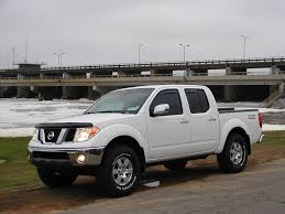 nissan frontier pro 4x lift kit pics of stock pro 4x w bfg or nitto anybody have pics