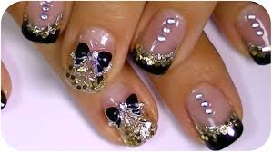 black and gold nail art design cute bow small rhinestones