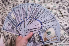 fan of a fan of hundred dollar bills hundred dollar