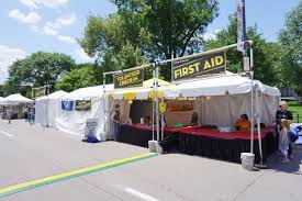 first aid tent and volunteer check in tent at summer of the arts aid tent and volunteer check in tent at summer of the arts