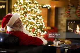 bokeh of tree lights with santa claus copy space stock