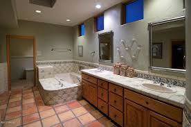 eclectic master bathroom with high ceiling sink in tucson