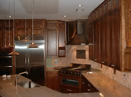 kitchen wooden tall kitchen cabinet with travertine backsplash