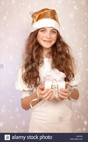 portrait of cute teen with christmas gift on snowy background