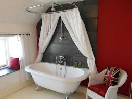 luxury bathroom with rolltop bath and rainhead shower over the