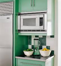 how to trim cabinet above refrigerator how to integrate a microwave for a more efficient kitchen