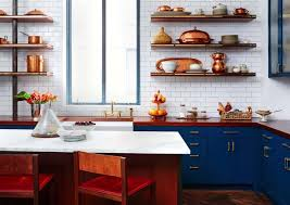 kitchen with blue cabinets reddish counters and open shelves