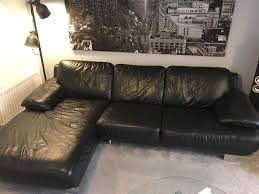 white and black leather corner sofa with swivel chair in reading