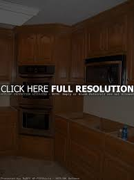 tall microwave cabinet home appliances decoration tall corner kitchen cabinet outofhome bbrown wooden corner kitchen pantry cabinet with stainless steel microwave