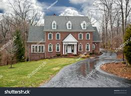brick twostory house secluded wooded setting stock photo 73373146
