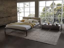 teak wood stained frame bed masculine bedding design tube white
