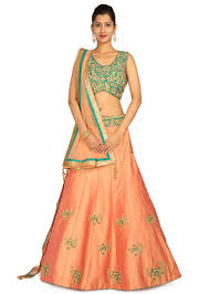 green and peach color lehenga with gold embroidery
