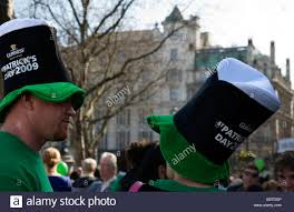 a wearing a guinness hat at st s day festival in