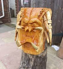predator carved out of a tree get to the wood choppa technabob