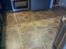 Regrouting Floor Tiles Tips by Installing Snapstone Kitchen Floor Tile For Our Home Remodel Ian