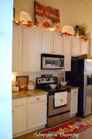 how to decorate above kitchen cabinets for fall adventures in decorating fall kitchen decor fall kitchen