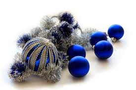 blue balls with silver tinsel in isolation on a white