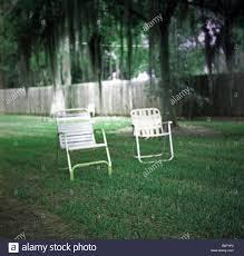 empty lawn chairs american deep south louisiana summer backyard
