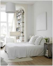 All White Bedroom by Wooden Dining Table Sleek Industrial Apartment Interior Design