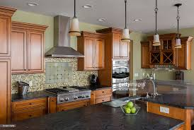 tile back splash and island in kitchen stock photo getty images