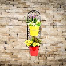 Metal Wall Planter by Black Metal Wall Planter With Red And Yellow Pots Mybageecha
