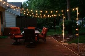 Backyard Party Lights by Support Poles For Patio Lights Made From Rebar And Electrical