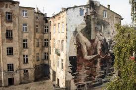 murals in lodz poland i support street arti support street art borondo lodz 1