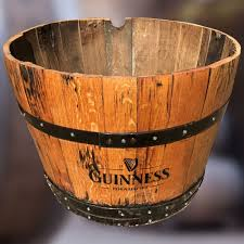 solid oak guinness branded half whisky barrel planter