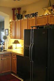 decorating ideas for small space above kitchen cabinets christmas