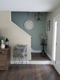 shade of blue on wall camoflauges tv love the chair too home