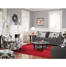 love the neutral room with the bright rug and patterned accent